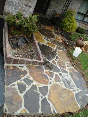 stone-walkway-and-belgium-blocks-to-accent-a-planter-area
